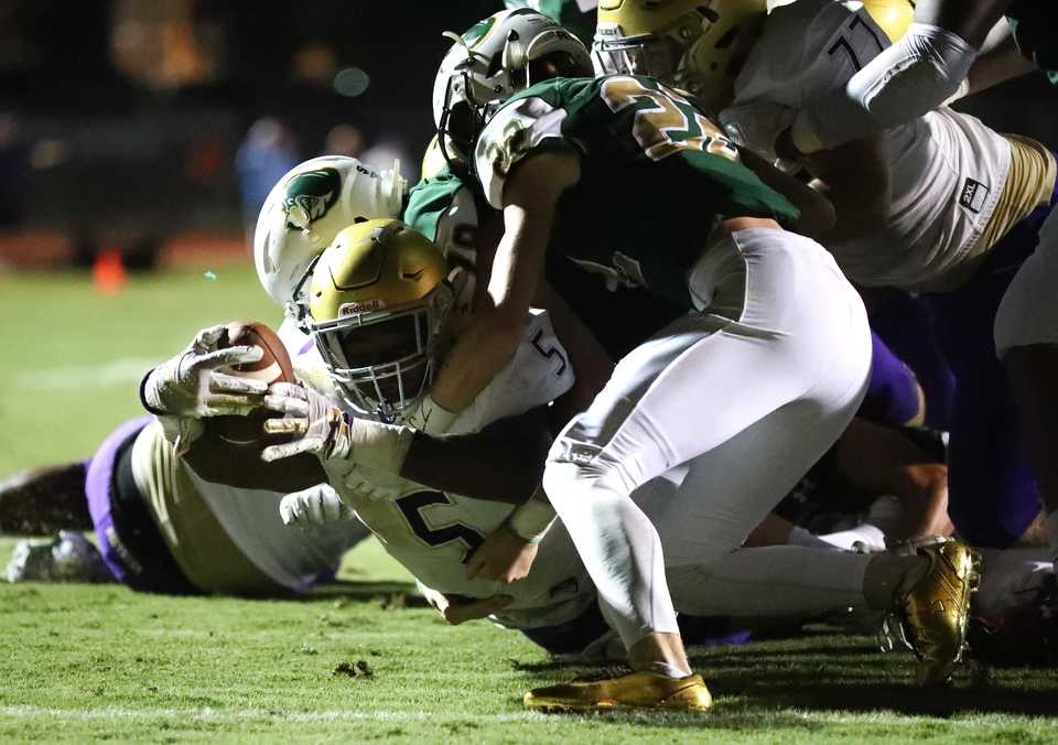 <strong>CBHS running back and linebacker Al Wooten lunges through a Briarcrest defense toward the end zone on Friday, Sept. 28.</strong> (Houston Cofield/Daily Memphian)