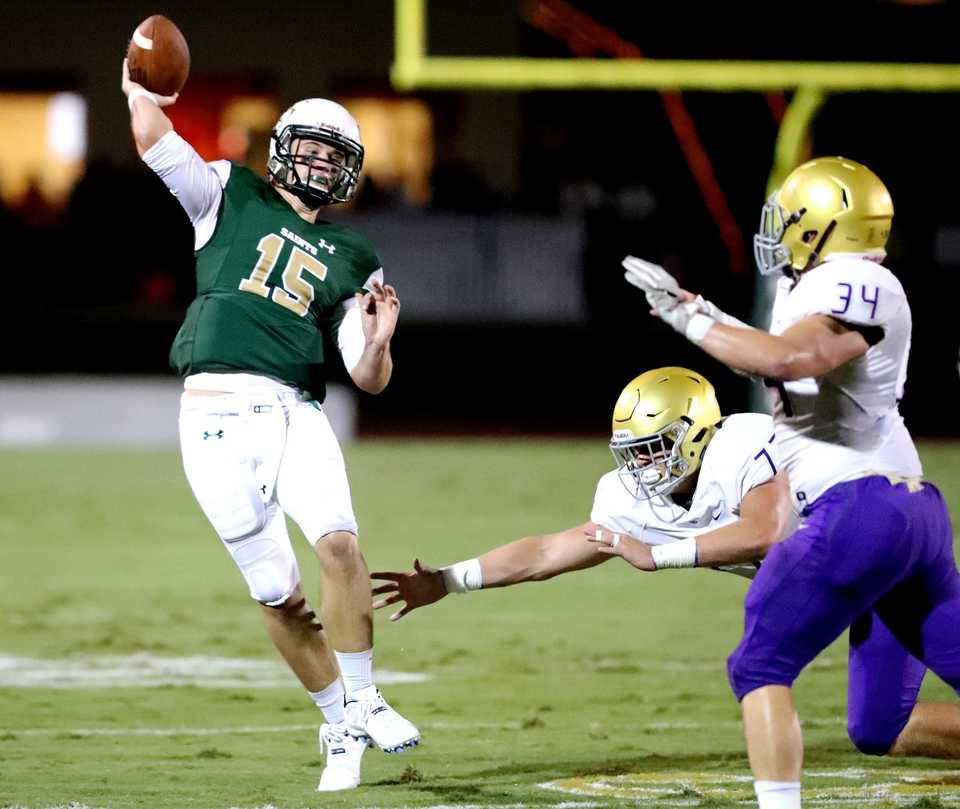 <strong>Briarcrest quarterback Jackson Walker skirts CBHS defenders as he throws a long pass toward the end zone on Friday, Sept. 28.</strong> (Houston Cofield/Daily Memphian)