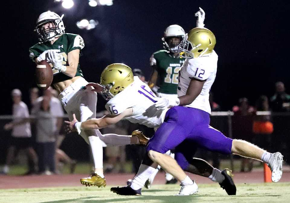 <strong>A Briarcrest receiver leaps for a pass in the end zone just before half time on Friday, Sept. 28.</strong> (Houston Cofield/Daily Memphian)