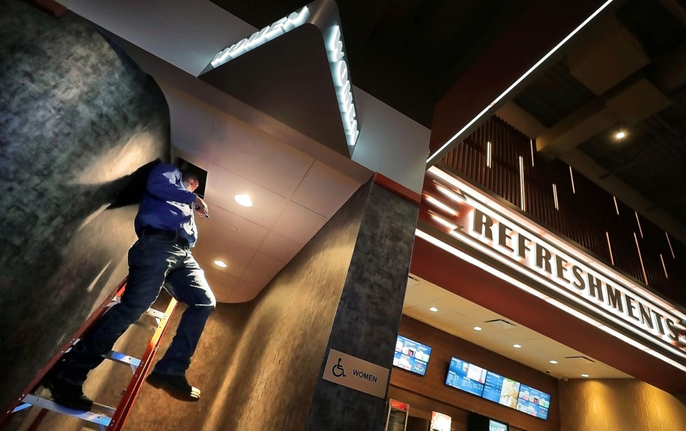 <strong>Wayne Ayers tests the heating and air conditioning at the new Malco Powerhouse theater on Thursday, March 7, 2019, as contractors and Malco employees make a few final adjustments and improvements before the opening of the Downtown Memphis theater.</strong> (Jim Weber/Daily Memphian)