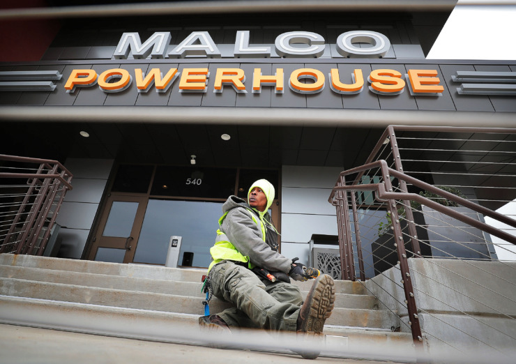 <strong>Joseph Ragland installs lighting on the front steps at the new Malco Powerhouse theater in Downtown Memphis on Thursday, March 7, 2019.</strong> (Jim Weber/Daily Memphian)