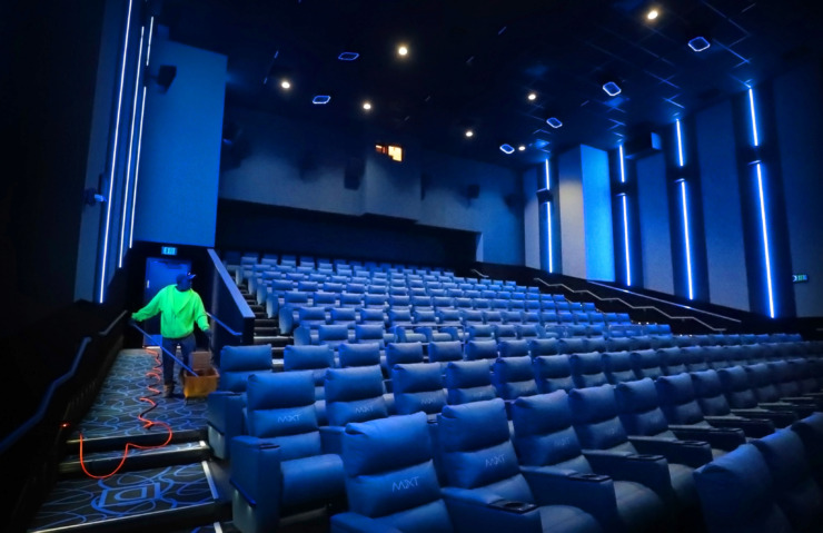 <strong>Contractors and Malco employees make a few final adjustments and improvements at the new Malco Powerhouse theater in Downtown Memphis on Thursday, March 7, 2019.</strong> (Jim Weber/Daily Memphian)