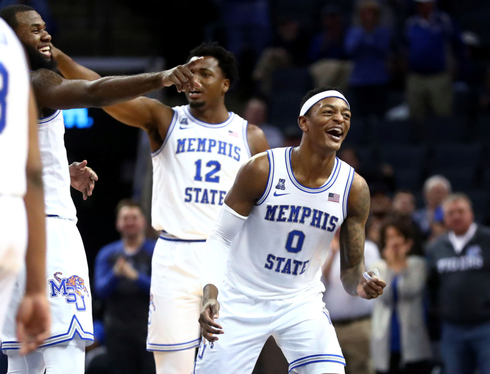 <strong>Memphis Tigers forward Kyvon Davenport (0) celebrates after guard Jeremiah Martin (3) breaks his own record scoring 43 points in a single game on Feb. 20, 2019. Davenport will play his last regular season home game on March 9 against the Tulsa Golden Hurricane.</strong> (Houston Cofield/Daily Memphian file)
