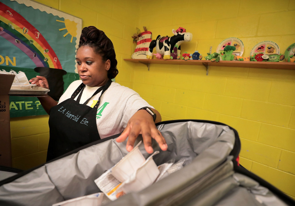 <strong>Corey Alexander prepares breakfast kits to be delivered to each class at E.A. Harrold Elementary School in Millington which was recognized by the No Kid Hungry initiative for their efforts to end childhood hunger through the school's breakfast program.</strong> (Jim Weber/Daily Memphian)