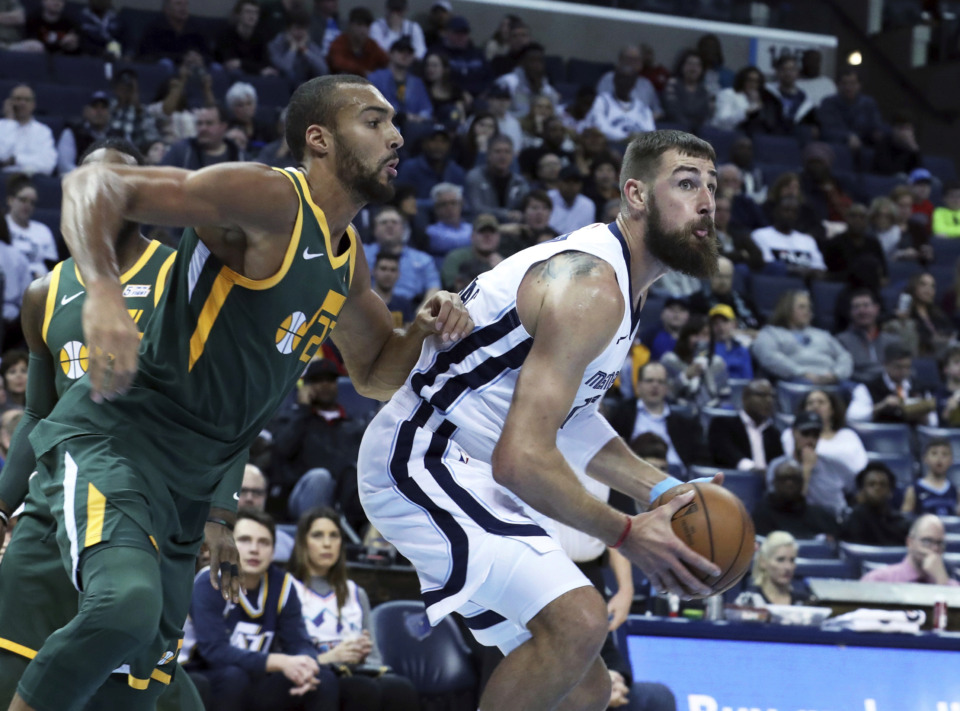 <strong>Memphis Grizzlies' Jonas Valanciunas, right, looks to the basket as Utah Jazz's Rudy Robert (27) defends during the first half of an NBA basketball game Friday, March 8, 2019, in Memphis, Tenn.</strong> (AP Photo/Karen Pulfer Focht)