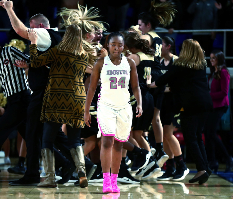 <strong>Houston High School Mustangs guard Destinee Wells hangs her head her team takes a tough loss in the state championship game on Saturday, Mar. 9, 2019. The Mustangs lost 46-44 after Bradley Central drained a buzzer beater to win the game.</strong> (Houston Cofield/Daily Memphian)