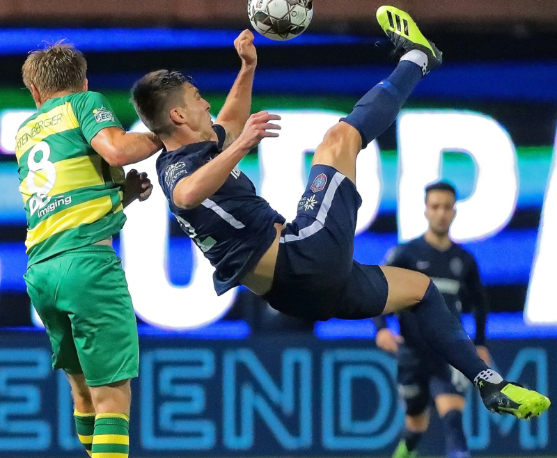 <strong>Wesley Charpie (right) attempts a bicycle kick past Tampa's Zach Steinberger (8) during the 901 FC season opener against the Tampa Rowdies at Autozone Park on March 9, 2019. The Rowdies beat Memphis 1-0 with a penalty kick early in the first half.</strong> (Jim Weber/Daily Memphian)
