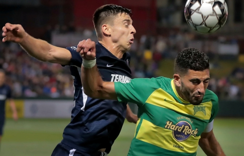 <strong>Wesley Charpie (left) goes head-to-head with Tampa's Sebastian Guenzatti during the 901 FC season opener against the Tampa Rowdies at Autozone Park on March 9, 2019. The Rowdies beat Memphis 1-0 with a penalty kick early in the first half.</strong> (Jim Weber/Daily Memphian)