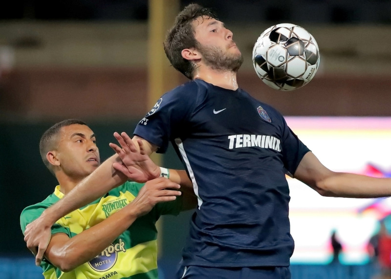 <strong>Forward Elliot Collier (right) blocks out Tampa's Tarek Morad during the 901 FC season opener against the Tampa Rowdies at Autozone Park on March 9, 2019. The Rowdies beat Memphis 1-0 with a penalty kick early in the first half.</strong> (Jim Weber/Daily Memphian)