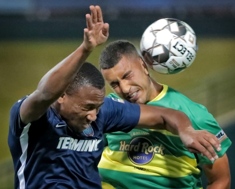 <strong>Rashawn Dally (left) goes head-to-head with Tampa's Tarek Morad during the 901 FC season opener against the Tampa Rowdies at Autozone Park on March 9, 2019. The Rowdies beat Memphis 1-0 with a penalty kick early in the first half.</strong> (Jim Weber/Daily Memphian)