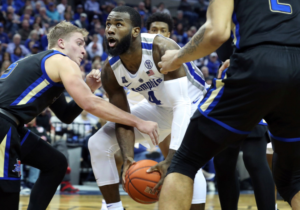 "<strong>University of Memphis forward Raynere Thornton (4) goes up for a basket while being defended by Tulsa Golden Hurricane's Lawson Korita (5) during the second half of a game at FedExForum on Saturday, March 9, 2019.</strong>&nbsp;<span class=""s1"">(Karen Pulfer Focht/Special to The Daily Memphian)</span>"