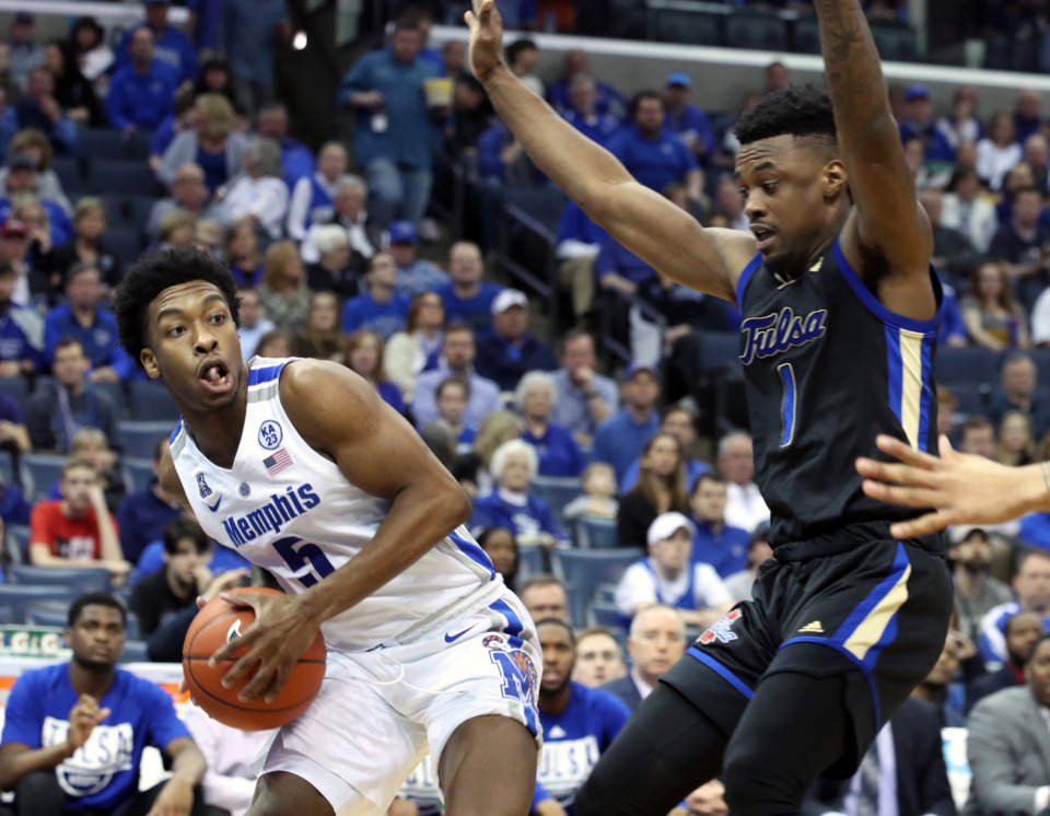 "<strong>University of Memphis guard Kareem Brewton (5) grabs a rebound as Tulsa Golden Hurricanes Martin Igbanu (1) defends during&nbsp;</strong><span class=""s1""><strong>a game at FedExForum on Saturday, March 9, 2019.&nbsp;</strong>(Karen Pulfer Focht/Special to The Daily Memphian)</span>"