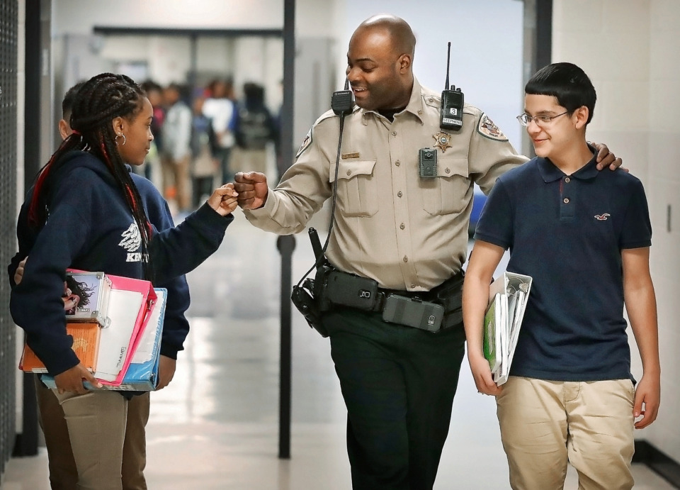 <strong>Shelby County Sheriff's Deputy Christopher Stephens, the resource officer at Kate Bond Middle School, walks the halls between classes encouraging kids to move along on March 1, 2019. Kate Bond is one of 28 Shelby County schools where resource officers were hired by the Sheriff's Office this year. Gov. Bill Lee wants to invest $30 million in a school safety grant to further increase the number of resource officers.</strong> (Jim Weber/Daily Memphian)