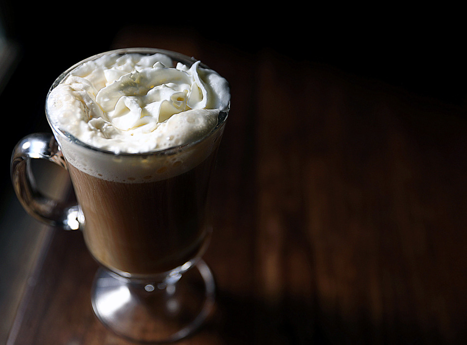<strong>A proper Irish coffee of strong coffee, brown sugar, Irish whiskey and a dollop of thick cream is a classic March cocktail.</strong> (Patrick Lantrip/Daily Memphian)