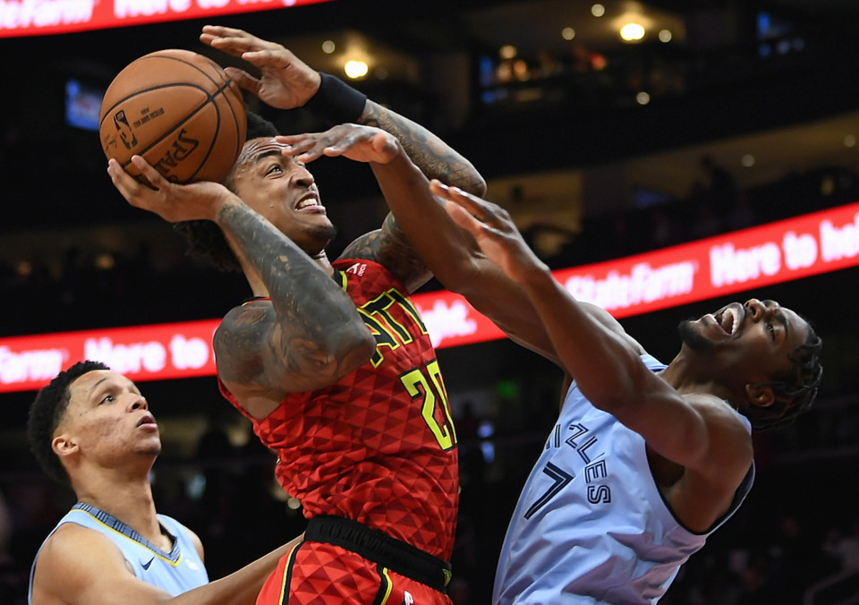 <span><strong>Atlanta Hawks forward John Collins is fouled by Memphis Grizzlies forward Justin Holiday (7) as he shoots during the first quarter of an NBA basketball game Wednesday, March 13, 2019, in Atlanta. Collins scored 27 points in the Hawks' 132-111 victory.</strong> (AP Photo/John Amis)</span>