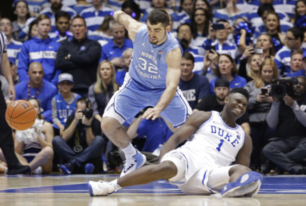 <strong>Duke's Zion Williamson (1) falls to the floor with an injury while chasing the ball during a game against North Carolina on Feb. 20, 2019.</strong> (AP Photo/Gerry Broome)