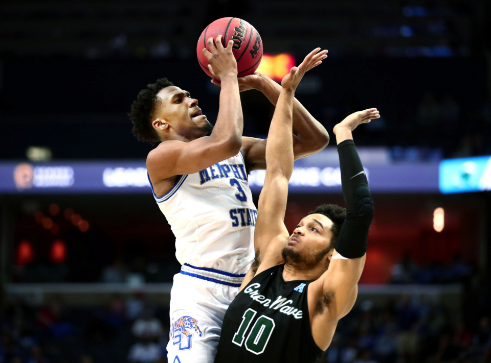 <strong>University of Memphis guard Jeremiah Martin (3) pulls up for a shot against Tulane guard Caleb Daniels (10) during an AAC Tournament game at FedExForum in Memphis on Thursday, Mar. 14, 2019.</strong> (Houston Cofield/Daily Memphian)