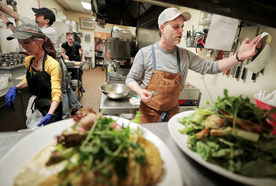 <strong>Chef Justin Young calls out orders during lunch at Raven &amp; Lily in Collierville's historic town square. Young worked under Erling Jensen at both La Tourelle and Erling Jensen&rsquo;s before opening his own restaurant.</strong> (Jim Weber/Daily Memphian)