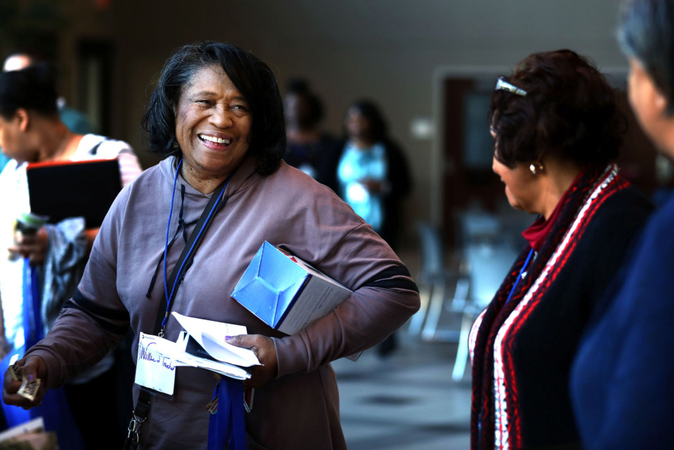 <strong>Willie Truehart (left), picks up some brochures from Alliance Healthcare Services as she mingles with other attendees at the Shelby County Opioid Summit at the University of Memphis Thursday, March 14, 2019. The summit, which continues Friday, includes talks on topics such as current treatment trends and hope for the future of battling the opioid crisis.</strong> (Houston Cofield/Daily Memphian)