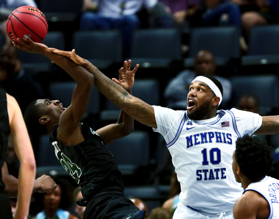 <strong>University of Memphis senior forward Mike Parks Jr. (10) reaches to block a shot during an American Athletic Conference Tournament game against Tulane on Thursday, March 14, 2019. Parks matched his season high with 14 points and set his career high with 13 rebounds in the Tigers' 83-68 win over the Green Wave.</strong> (Houston Cofield/Daily Memphian)