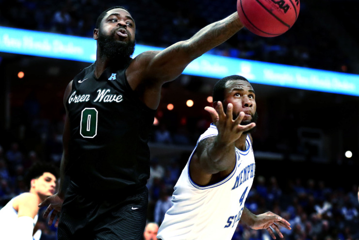<strong>University of Memphis senior forward Raynere Thornton (4) reaches for a rebound against Tulane Green Wave guard Jordan Cornish (4) during an AAC Tournament game Thursday, March 14, 2019. The Tigers need strong performances from their seniors as Memphis advances to the second round.</strong> (Houston Cofield/Daily Memphian)
