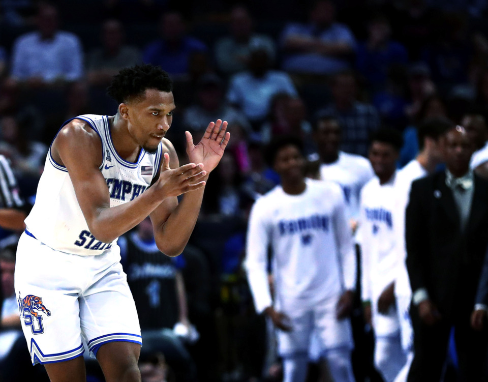 "<strong>Memphis senior guard Jeremiah Martin (3) celebrates after draining a 3-point shot during the Tigers' American Athletic Conference tournament win over Tulane on Thursday, March 14, 2019. Memphis plays UCF at 1 p.m. Friday in what coach Penny Hardway is calling ""the biggest game of the year, by far.""</strong> (Houston Cofield/Daily Memphian)"