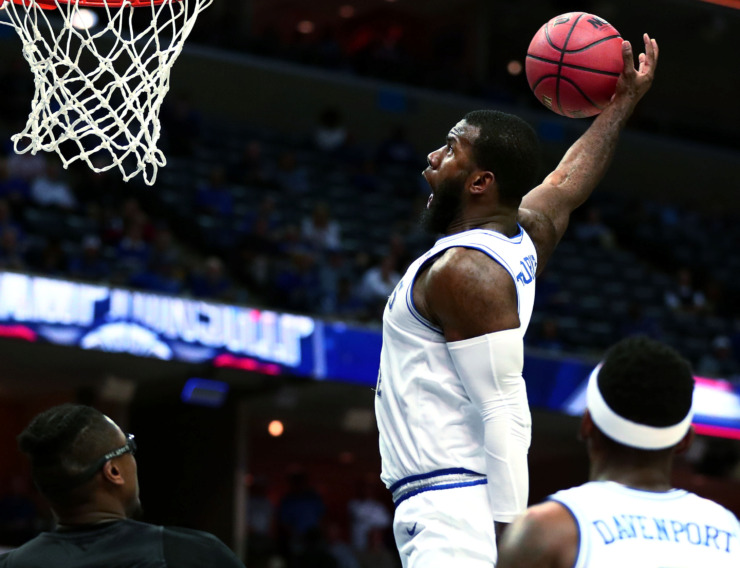 <strong>University of Memphis senior forward Raynere Thornton (4) raises up for a dunk during an AAC Tournament game against Tulane on Thursday, March 14, 2019. The Tigers beat the Green Wave 83-68 and face UCF in the second round of the tournament Friday.</strong> (Houston Cofield/Daily Memphian)