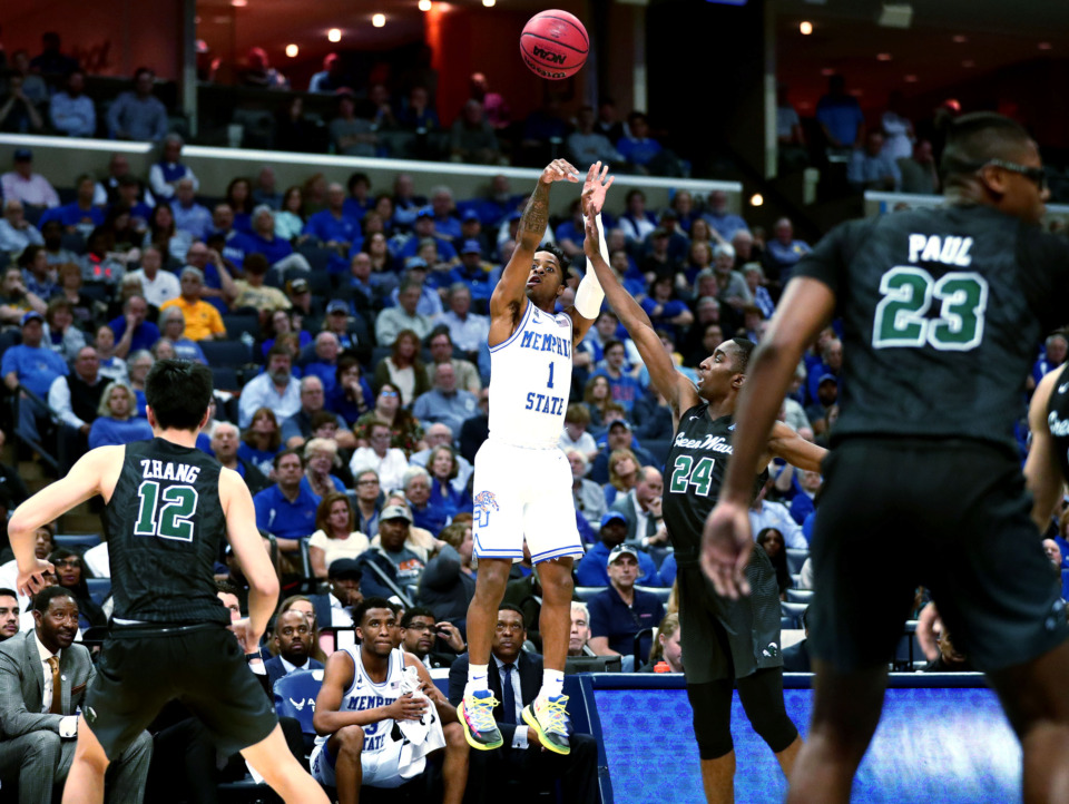 <strong>University of Memphis guard Tyler Harris (1) shoots a three-pointer during an AAC Tournament game against the Tulane Green Wave. The Tigers beat the Green Wave 83-68 to move on to the next round of the tournament.</strong> (Houston Cofield/Daily Memphian)