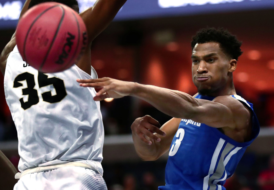 <strong>University of Memphis guard Jeremiah Martin (3) passes the ball to a teammate during an AAC tournament game against UCF on Friday, March 15, 2019, at FedExForum in Memphis.</strong> (Houston Cofield/Daily Memphian)