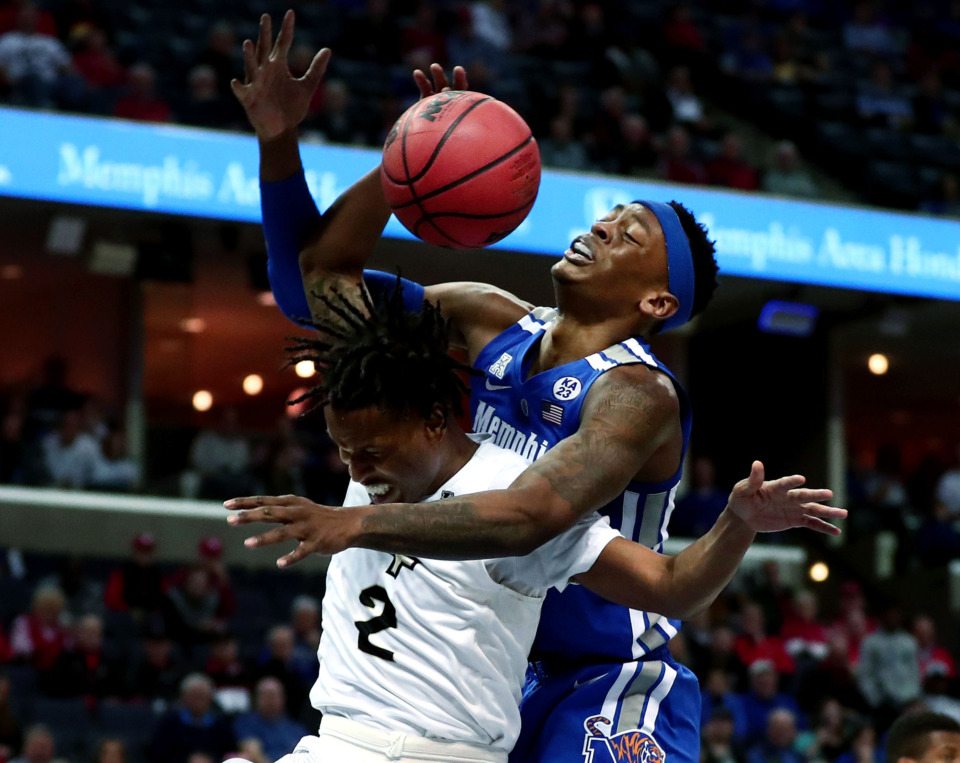 "<strong>University of Memphis forward Kyvon Davenport (0) reaches for a rebound against University of Central Florida guard Terrell Allen (2)&nbsp;</strong><span class=""s1""><strong>during an AAC tournament game against UCF on Friday, March 15, 2019, at FedExForum in Memphis. </strong>(Houston Cofield/Daily Memphian)</span>"