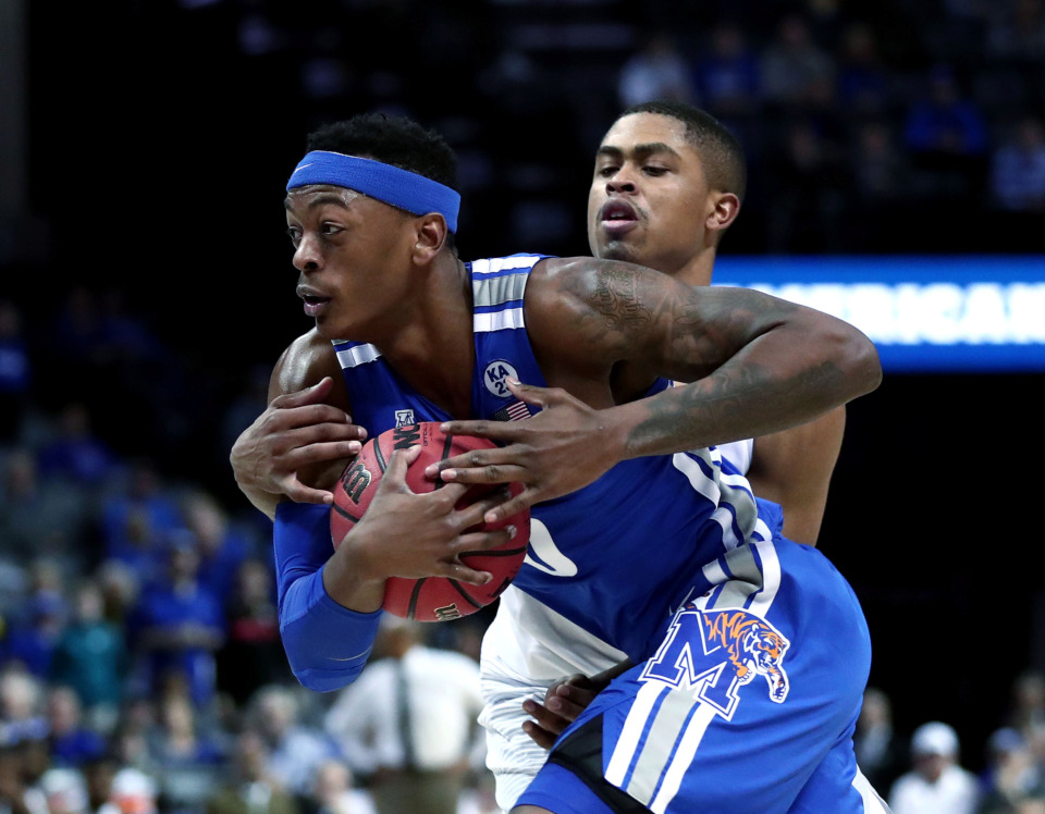 "<strong>University of Memphis forward Kyvon Davenport (0) drives to the basket&nbsp;</strong><span class=""s1""><strong>during an AAC tournament game against UCF on Friday, March 15, 2019, at FedExForum in Memphis. </strong>(Houston Cofield/Daily Memphian)</span>"
