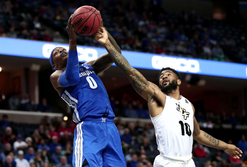 "<span class=""s1""><strong>University of Memphis forward Kyvon Davenport (0) pulls a rebound away from University of Central Florida guard Dayon Griffin (10) during an AAC tournament game against UCF on Friday, March 15, 2019, at FedExForum in Memphis. </strong>(Houston Cofield/Daily Memphian)</span>"