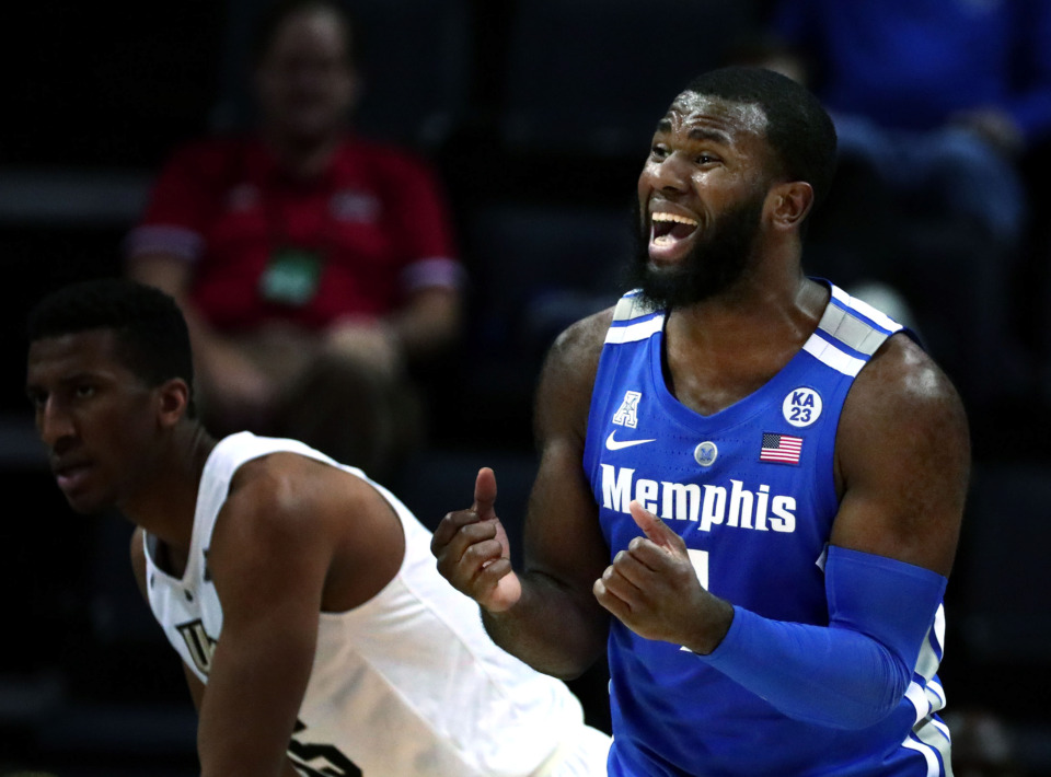 "<strong>University of Memphis forward Raynere Thornton (4) reacts to a foul call by the referee&nbsp;</strong><span class=""s1""><strong>during an AAC tournament game against UCF on Friday, March 15, 2019, at FedExForum in Memphis. </strong>(Houston Cofield/Daily Memphian)</span>"