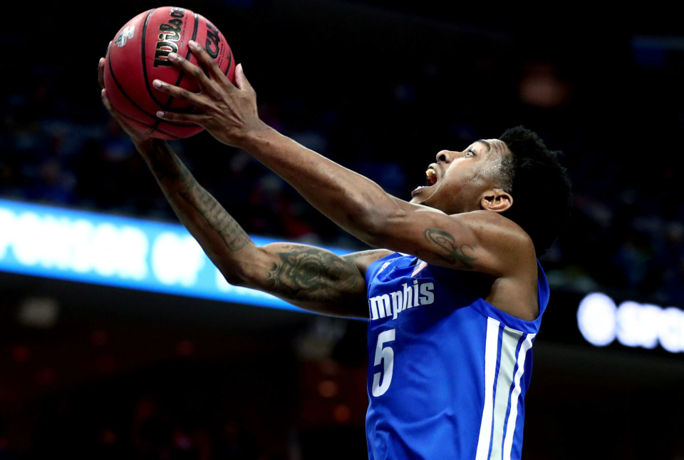 "<strong>University of Memphis guard Kareem Brewton Jr. (5) drives to the basket for a layup&nbsp;</strong><span class=""s1""><strong>during an AAC tournament game against UCF on Friday, March 15, 2019, at FedExForum in Memphis. </strong>(Houston Cofield/Daily Memphian)</span>"