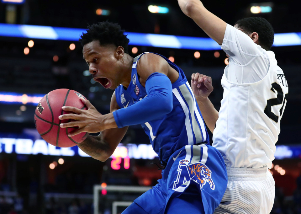 "<strong>University of Memphis guard Tyler Harris (1) snatches the ball before it goes out of bounds&nbsp;</strong><span class=""s1""><strong>during an AAC tournament game against UCF on Friday, March 15, 2019, at FedExForum in Memphis. </strong>(Houston Cofield/Daily Memphian)</span>"
