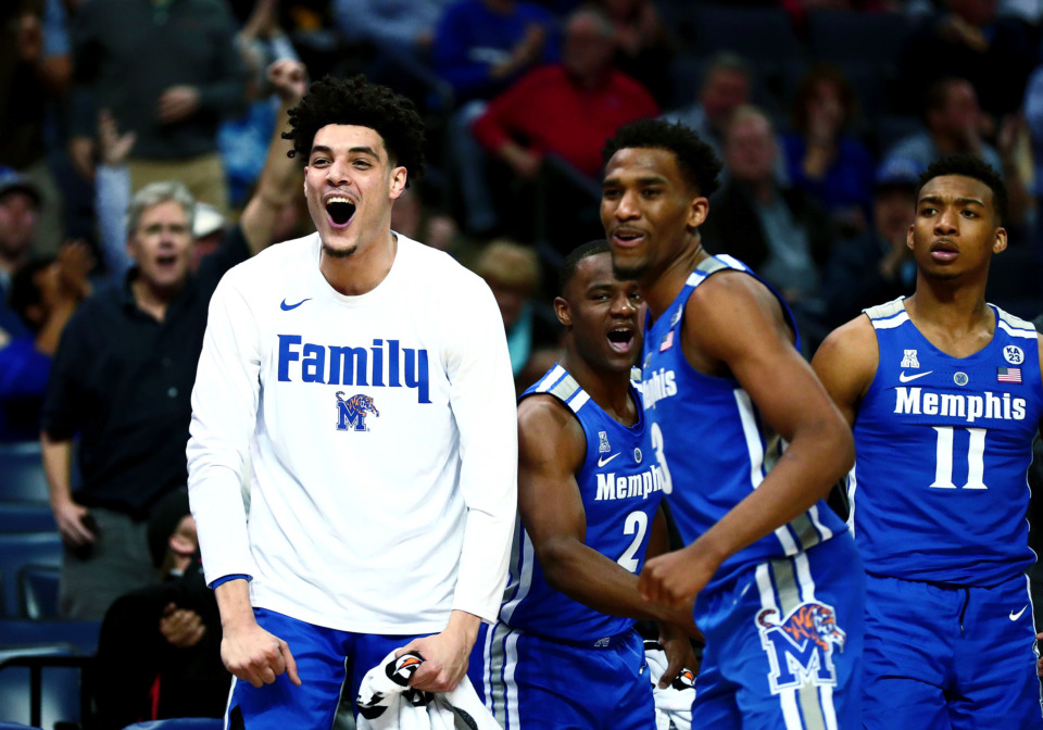 <strong>University of Memphis forward Isaiah Maurice (14), guard Jeremiah Martin (3), and guard Antwann Jones (11) celebrate after the Tigers drain a 3-pointer during the American Athletic Conference quarterfinals game against Central Florida on Friday, March 15, 2019. The Tigers beat UCF 79-55 and advance to face Houston Saturday.</strong> (Houston Cofield/Daily Memphian)