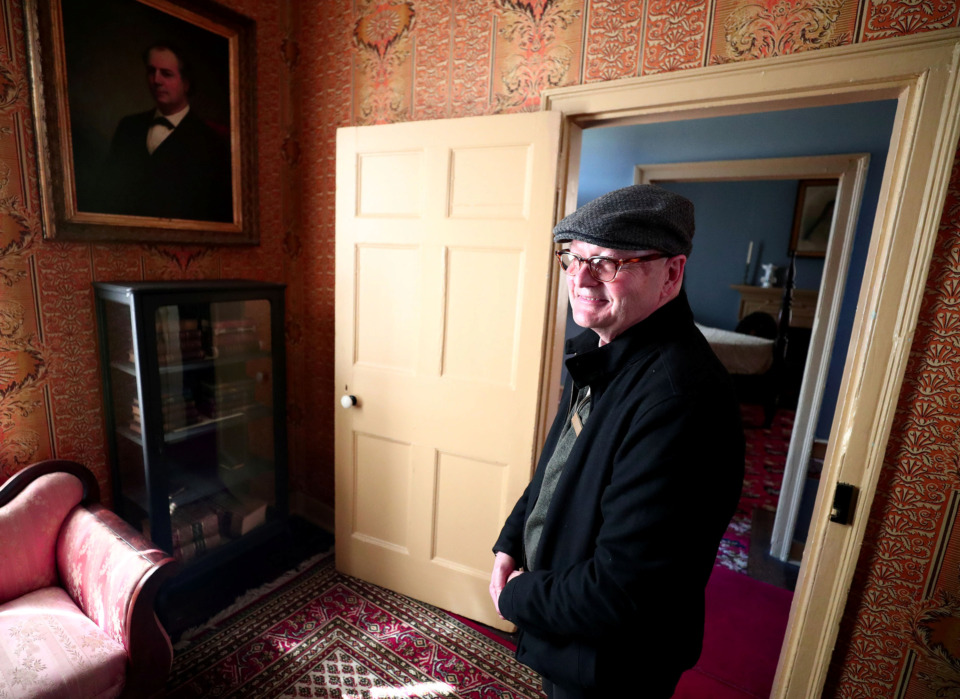 <strong>Randle Witherington leads a tour of the Magevney House on Adams Avenue on Friday, March 15, 2019. The house is offering free tours every Friday from 11 a.m. to 2 p.m. through April 12.</strong> (Houston Cofield/Daily Memphian)