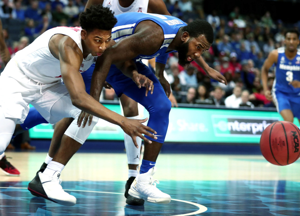 "<strong>University of Memphis forward Raynere Thornton (4) tries to reach the ball before Houston Cougars guard Nate Hinton (11) gets to it&nbsp;<span class=""s1"">during a semifinal game against Houston in the American Athletic Conference tournament on Saturday, March 16, 2019, at FedExForum in Memphis. </span></strong><span class=""s1"">(Houston Cofield/Daily Memphian)</span>"