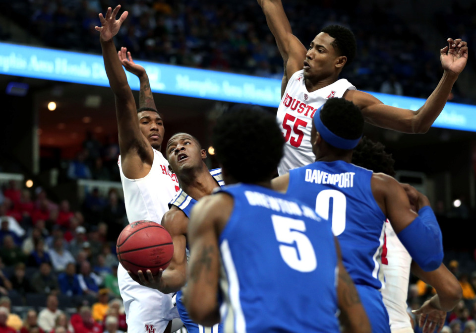 "<strong>University of Memphis guard Alex Lomax (2) weaves through the Houston defense as he drives toward the basket&nbsp;<span class=""s1"">during a semifinal game against Houston in the American Athletic Conference tournament on Saturday, March 16, 2019, at FedExForum in Memphis.</span></strong><span class=""s1""> </span><span class=""s1"">(Houston Cofield/Daily Memphian)</span>"