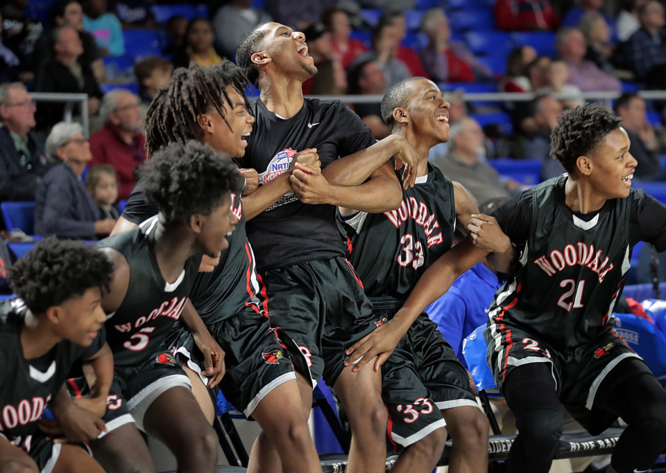 <strong>Wooddale's bench celebrates in the last few seconds of Wooddale's TSSAA Class AA state basketball finals win over Knoxville Fulton at MTSU in Murfreesboro on March 16, 2019.</strong> (Jim Weber/Daily Memphian)