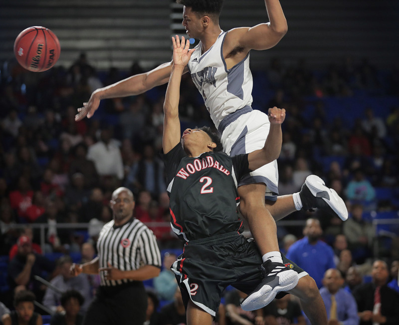 <strong>Wooddale's Kevin Brown collides with Ron Davis from Fulton on a shot attempt during Wooddale's TSSAA Class AA state basketball finals game against Knoxville Fulton at MTSU in Murfreesboro on March 16, 2019.</strong> (Jim Weber/Daily Memphian)