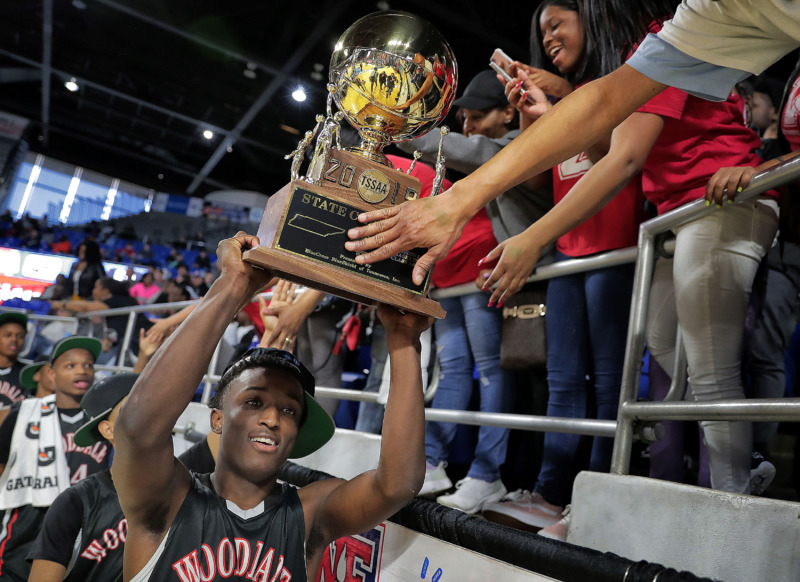 <strong>Wooddale's Alvin Miles parades the trophy by fans after Wooddale's TSSAA Class AA state basketball finals win over Knoxville Fulton at MTSU in Murfreesboro on March 16, 2019.</strong> (Jim Weber/Daily Memphian)