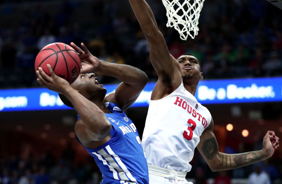 "<strong>University of Memphis guard Alex Lomax (2) charges the basket for a layup against Houston guard Armoni Brooks (3)&nbsp;<span class=""s1"">during a semifinal game&nbsp;against Houston in the American Athletic Conference tournament on Saturday, March 16, 2019. </span></strong><span class=""s1"">(Houston Cofield/Daily Memphian)</span>"