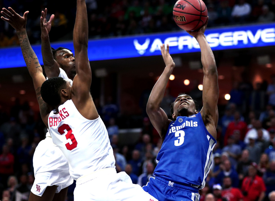 "<strong>University of Memphis guard Jeremiah Martin (3) goes for a shot over Houston guard Armoni Brooks (3)&nbsp;</strong><span class=""s1""><strong>during a semifinal game of the American Athletic Conference tournament against Houston on Saturday, March 16, 2019.</strong> (Houston Cofield/Daily Memphian)</span>"