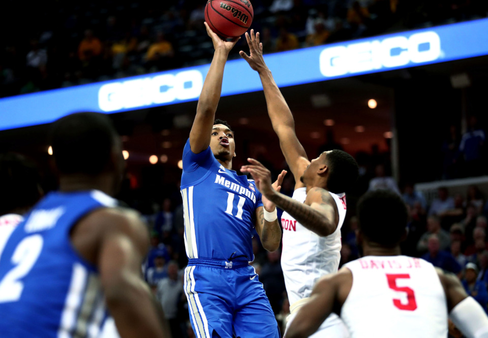 "<strong>University of Memphis guard Antwann Jones (11) raises up for a jump shot&nbsp;</strong><span class=""s1""><strong>during a semifinal game of the American Athletic Conference tournament against Houston on Saturday, March 16, 2019.</strong> (Houston Cofield/Daily Memphian)</span>"