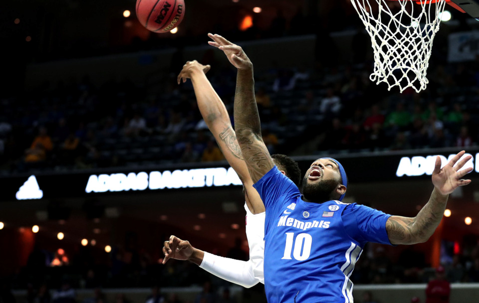 "<strong>University of Memphis forward Mike Parks Jr. (10) leaps for a rebound&nbsp;</strong><span class=""s1""><strong>during a semifinal game in the American Athletic Conference tournament against Houston on Saturday, March 16, 2019.</strong> (Houston Cofield/Daily Memphian)</span>"