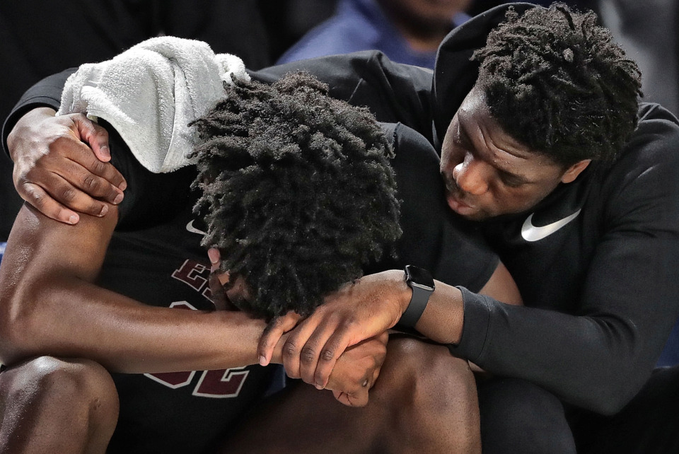 <strong>East High School's James Wiseman is comforted by Malcolm Dandridge (right) after Wiseman fouled out late in the 4th quarter during East's TSSAA Class AAA state basketball finals game against Bearden at MTSU in Murfreesboro on March 16, 2019.</strong> (Jim Weber/Daily Memphian)