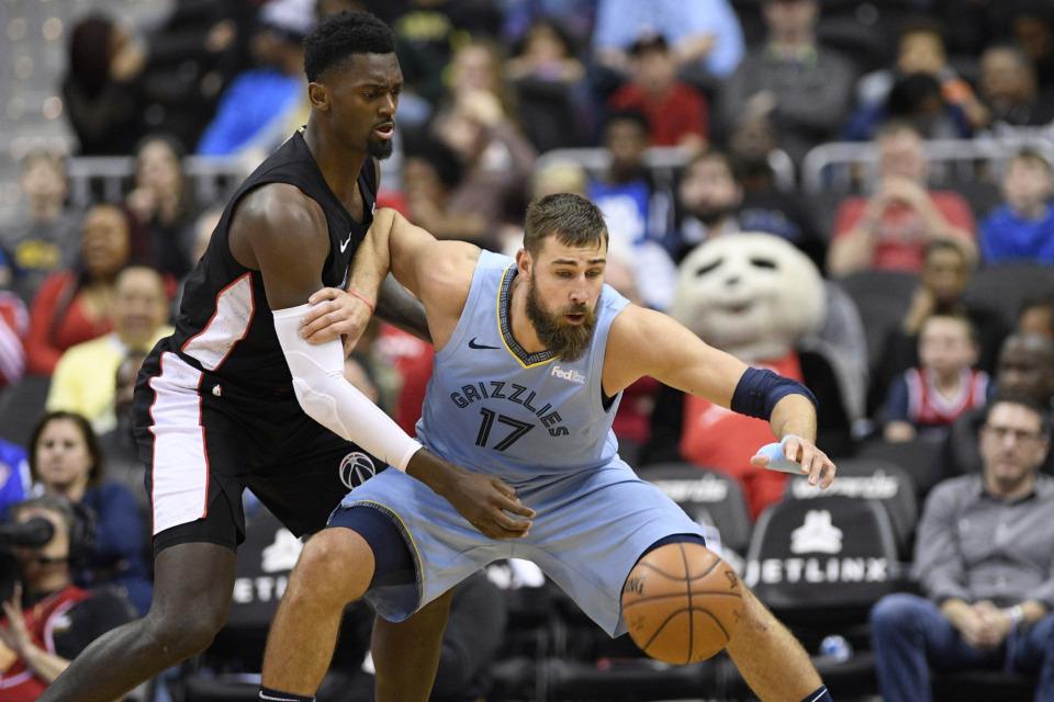<span><strong>Memphis Grizzlies center Jonas Valanciunas (17) reaches for the ball against Washington Wizards forward Bobby Portis, left, during the first half of an NBA basketball game, Saturday, March 16, 2019, in Washington.</strong> (AP Photo/Nick Wass)</span>