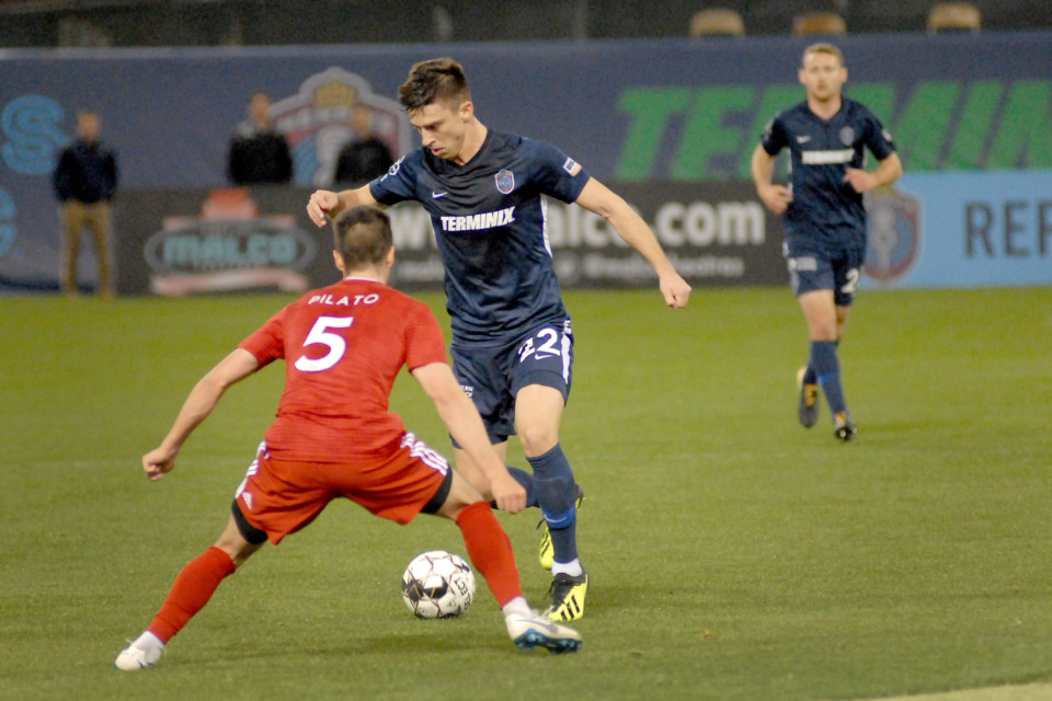 <strong>Memphis 901 FC defender Wes Charpie (#22) works the ball upfield against Noah Pilato (#5) of Loudoun United on Saturday, March 16, 2019, at AutoZone Park in Memphis. The match ended in a 1-1 tie.</strong> (Stan Carroll/Special to The Daily Memphian)