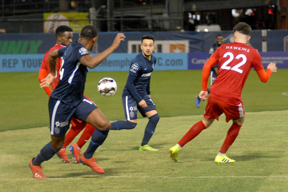 <strong>Memphis 901 FC players Adam Najem (#10) and Rashawn Dally (#14) work the ball toward the goal durng a match against Loudoun United on Saturday, March 16, 2019, at AutoZone Park in Memphis. The match ended in a 1-1 tie.</strong> (Stan Carroll/Special to The Daily Memphian)